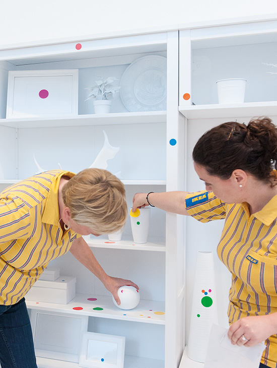 Staff from IKEA inspect Yayoi Kusama's The Obliteration Room 2014