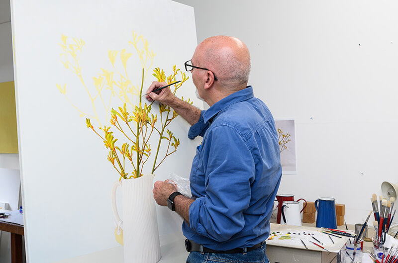 John Honeywill painting in his studio