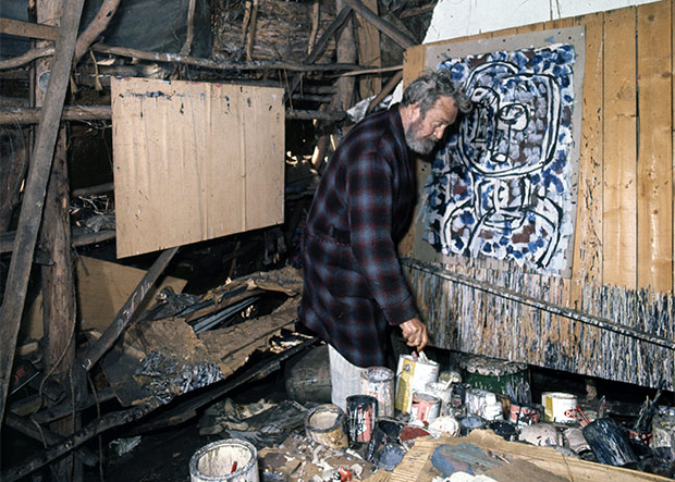 Ian Fairweather painting in his studio on Bribie Island, 1972